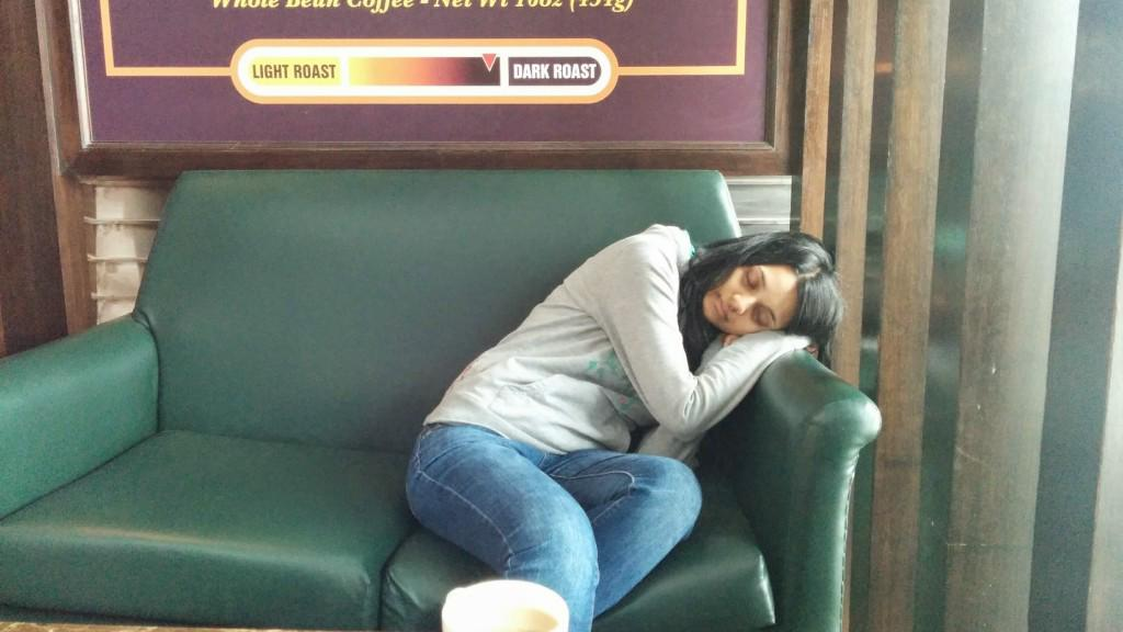 Kim exhausted from all flight delays, taking a nap in New Delhi Airport